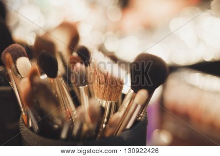 Set of professional brushes for make up. Macro no models fading film colors