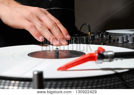 Hands Of Dj Pplaying Music On Vinyl Records