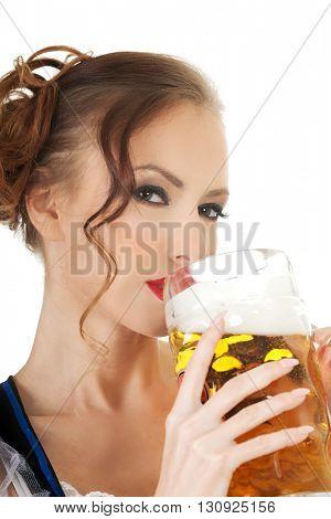 Bavarian woman drinking beer.
