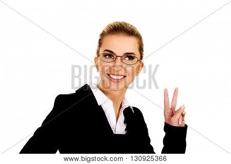 Happy businesswoman shows victory sign