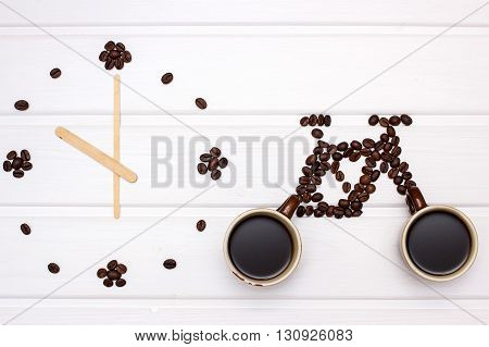 Clock And  Figures Of Bike With Coffee Beans