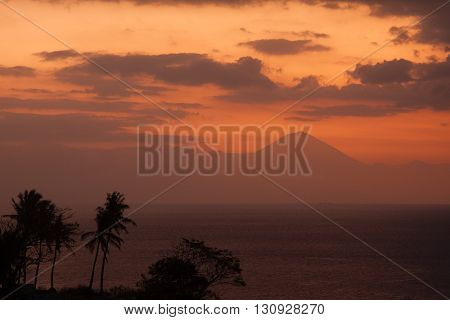 View from Lombok to Bali Vulcano Gunung Agung with beautiful sunset