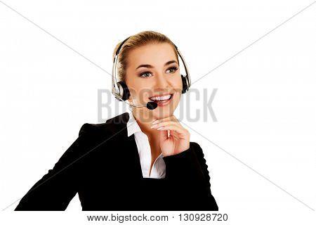 Young helpline operator in headset
