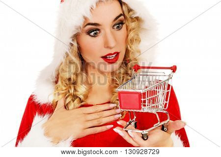 Surprised santa woman holding a small trolley