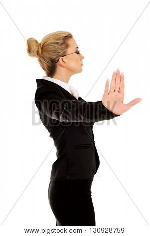 Businesswoman show NO gesture with confident expression
