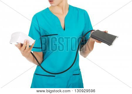 Shocked nurse or doctor with pressure gauge