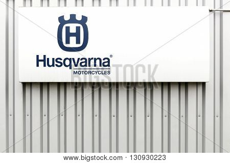 Villefranche, France - March 20, 2016: Husqvarna  motorcycles logo on a facade.  Husqvarna is swedish a manufacturer of robotic mowers, garden tractors, chainsaws, trimmers, bicycles and motorcycles