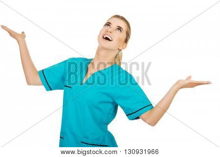 Young smile woman doctor or nurse catches something from the air