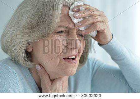 Portrait of an ill senior woman close up