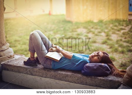 Lazy student relaxing herself
