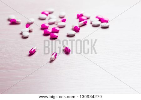 Medication for treatment of colds flu and runny on wooden background