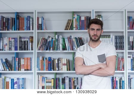 Student reading book in school library. Study lessons for exam. Hard worker and persistance concept.