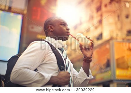Man drinking while walking to work