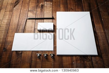 Photo of blank stationery set. Blank stationery template for branding identity for designers. Letterhead business cards envelope and pencil.