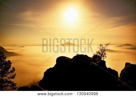 Island With Tree In Misty Ocean. Full Moon Night In  Beautiful Mountain. Sandstone Peaks  Increased