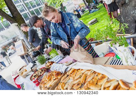 Helsinki Finland - May 21 2016: Helsinki Restaurant Day 2016. It is a traditional street carnival of food. Participants sign up on the website and get cooking. Members selling homemade pies