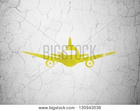 Tourism concept: Yellow Aircraft on textured concrete wall background