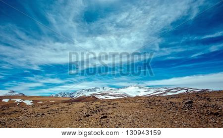 Snowy mountains. Severe mountains peaks covered by snow. Russia Siberia Altai mountains Chuya ridge.