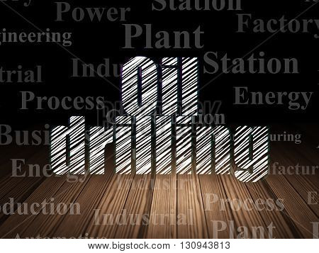 Manufacuring concept: Glowing text Oil Drilling in grunge dark room with Wooden Floor, black background with  Tag Cloud
