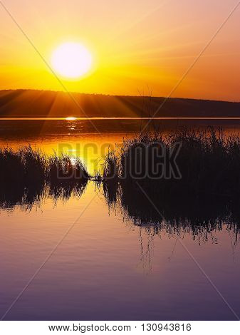 Beautiful sunset over calm lake. Dusk time