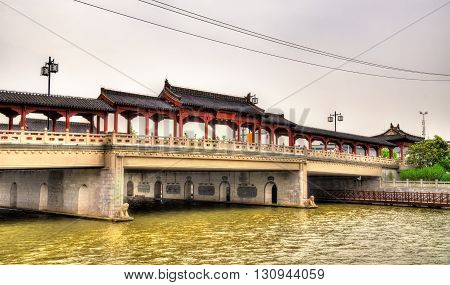 Traditional-style bridge abouve a canal in Suzhou, China