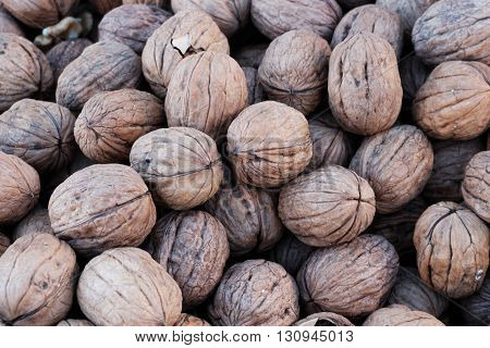 A big group of whole walnuts together