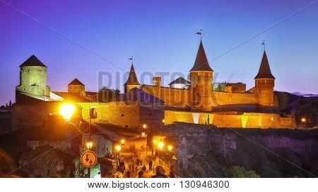 Castle at a moonlight night. Illuminationed castle. Kamenets-podolsky. Ukraine