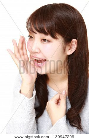 portrait of young Japanese woman shout something on white background