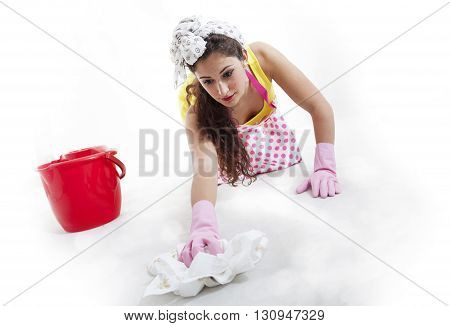 Pretty Woman With Cloth And Bucket Cleaning The Floor