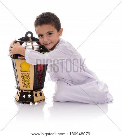 Happy Young Boy Hugging Ramadan Lantern