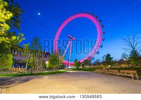 LONDON, ENGLAND - May 14, 2016 : The London Eye near the River Thames  in London at dusk, England. The London Eye is a giant Ferris wheel on the South Bank of the River Thames in London.