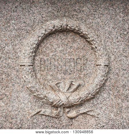 Granite stone wreath bass relief symbol of memory monument detail