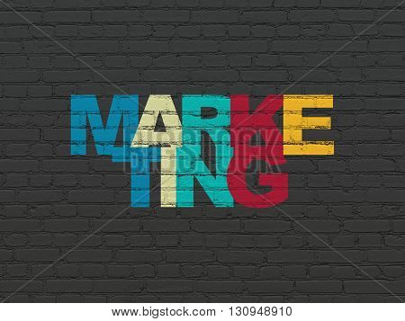 Advertising concept: Painted multicolor text Marketing on Black Brick wall background