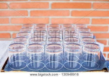 Many empty glasses ready for reception on a tray selective focus