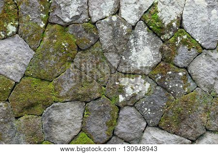 the mossy rustic stone wall for background