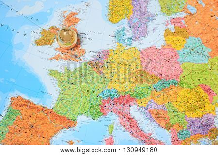 MANSFIELD ENGLAND - MAY 13: A 'Golden Egg' on top of a map of Europe. Suggesting Britain is the 'Golden Goose'. In Mansfield England. On 13th May 2016.