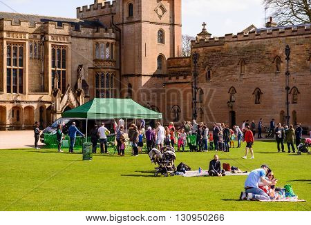 NEWSTEAD ENGLAND - MARCH 25: A family with young boy enjoy a picnic on lawn in front of Newstead Abbey. At Newstead Abbey Newstead Nottinghamshire England. On 25th March 2016.