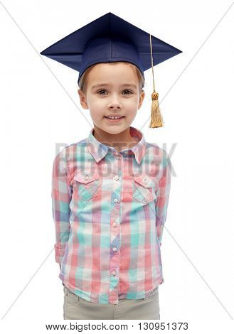 childhood, school, education, learning and people concept - happy girl with in bachelor hat or mortarboard