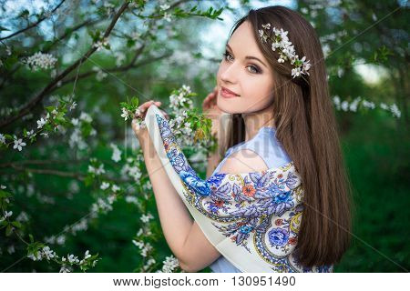 Happy Young Woman Walking In Blooming Summer Garden