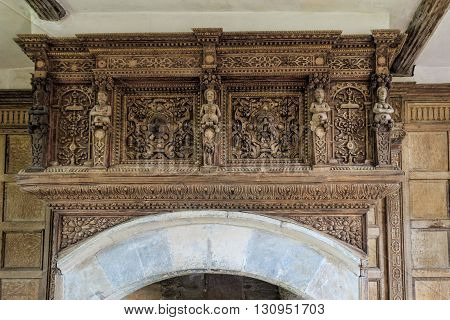 STOKESAY ENGLAND - FEBRUARY 21: Detail of wood carvings above a fireplace in the South Tower at Stokesay Castle. In Stokesay Ludlow England. On 21st February 2016.