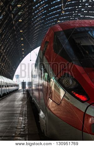 Red Train in Milan Central Railway Station Italy