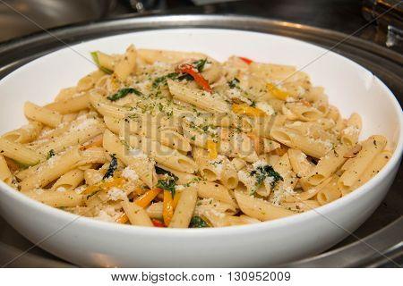 Closeup fried macaroni with sausage in dish