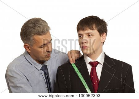 Tailor measuring client for custom made suit tailoring isolated on a white background