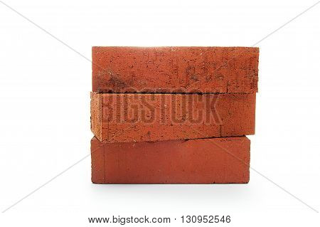 three red clay bricks stacked isolated on white