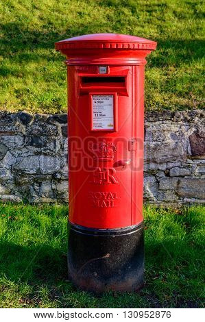 WYMESWOLD ENGLAND - JANUARY 15: A rural British red traditional Royal Mail pillar box. In Wymeswold England on 15th January 2016.