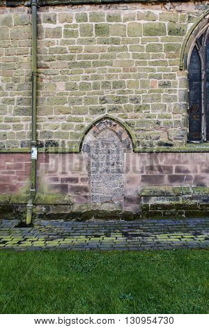 GEDLING ENGLAND - FEBRUARY 10: A bricked up doorway of All Hallows Church Of England church. In Gedling Nottinghamshire England. On 10th February 2016.