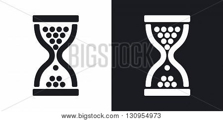 Vector hourglass icon. Two-tone version on black and white background