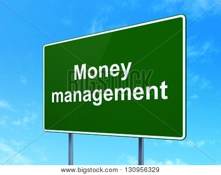 Currency concept: Money Management on green road highway sign, clear blue sky background, 3D rendering