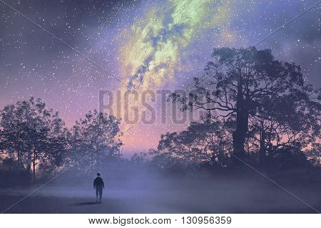 man standing against the milky way above silhouetted trees, night sky, scenery illustration