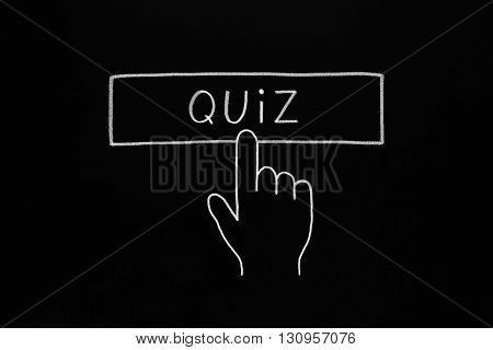 Hand cursor clicking Quiz button drawn with white chalk on blackboard.